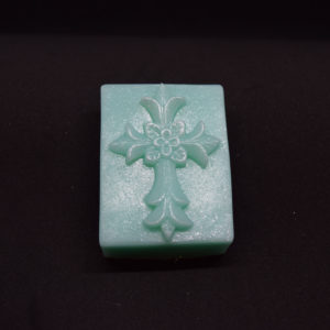 Bar with a decorated cross on it, novelty glycerin soap.