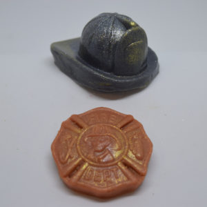 Fireman's hat and badge novelty glycerin soap.